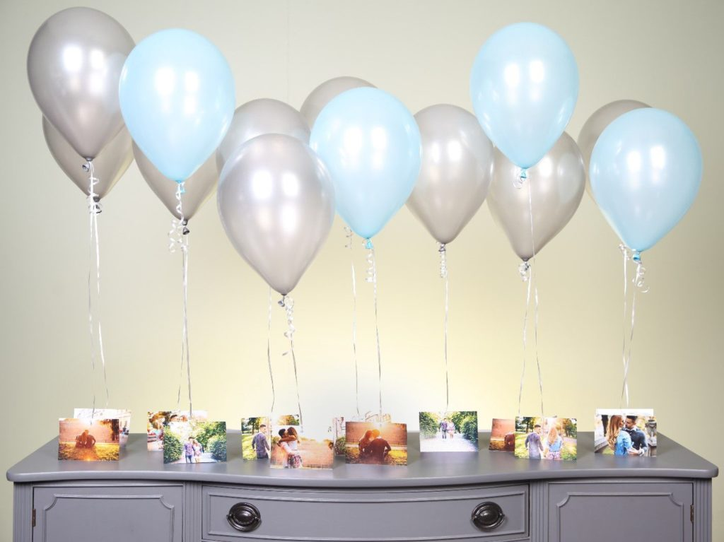Hang photo with balloons